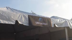 The old Sierra Games logo, printed on a banner and hung at the top of a white pavilion